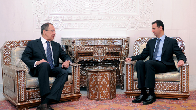 A handout picture released by the Syrian Arab News Agency (SANA) shows Syria's President Bashar al-Assad (R) meeting with Russian Foreign Minister Sergei Lavrov at the presidential palace in Damascus, on February 7, 2012 (AFP Photo)