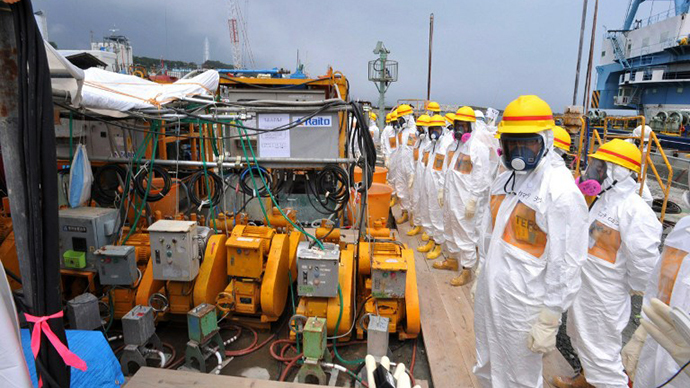 This photo taken on August 6, 2013 shows local government officials and nuclear experts inspecting a facility to prevent seeping of contamination water into the sea at Tokyo Electric Power's (TEPCO) Fukushima Dai-ichi nuclear plant in Okuma, Fukushima prefecture. (AFP Photo)