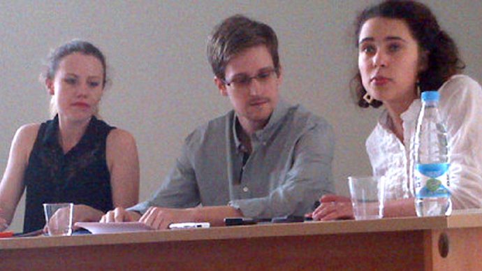 US National Security Agency (NSA) fugitive leaker Edward Snowden (C) during a meeting with rights activists, with among them Sarah Harrison of WikiLeaks (L), at Moscow's Sheremetyevo airport, on July 12, 2013 (Tanya Lokshina / Human Rights Watch). Video courtesy: Rossiya 24 TV channel