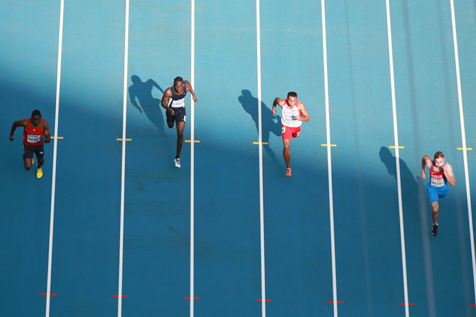 Russia's sprinter Aleksandr Bredvnev (right) passes 100 meters qualification run at the World Athletic Championship in Moscow. (RIA Novosti/Anton Denisov)