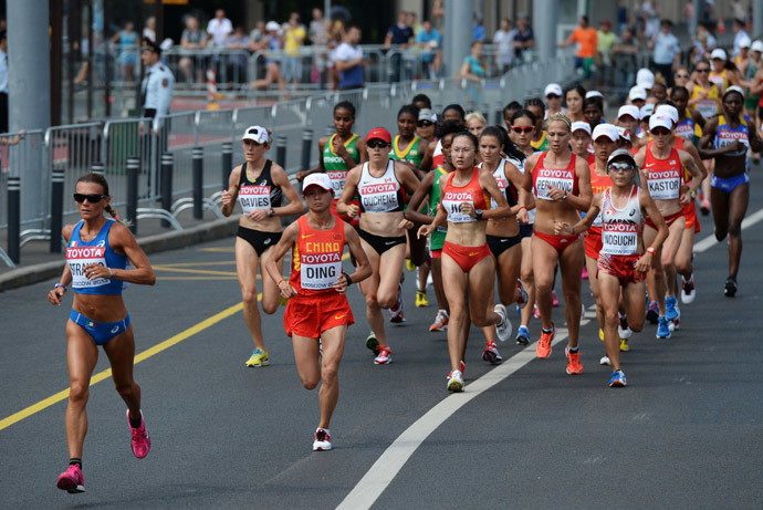 Italy's Valeria Straneo, left, in the women's marathon at the World Athletics Championships in Moscow. (RIA Novosti/Alexey Filippov)