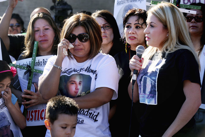 Protesters show support for victims killed by Border Patrol agents during a rally at the U.S.-Mexico border in San Ysidro, California February 23, 2013. (Reuters/Sandy Huffaker)