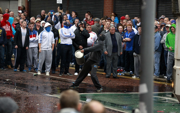 Loyalist protesters attack the police as they wait for a republican parade to make its way through Belfast City Centre, August 9, 2013. (Reuters/Cathal McNaughton)