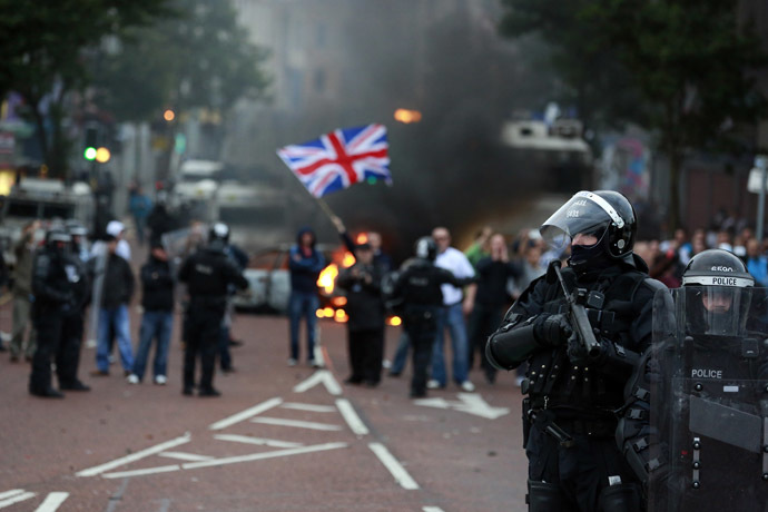 Police officers patrol the streets after loyalist protesters attacked the police with bricks and bottles as they waited for a republican parade to make its way through Belfast City Centre, August 9, 2013. (Reuters/Cathal McNaughton)