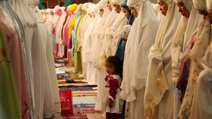 """Muslims attend a mass prayer session """"Tarawih"""" marking the beginning of the holy fasting month of Ramadan at a mosque in Makassar of Indonesia's South Sulawesi province.(Reuters / Yusuf Ahmad)"""
