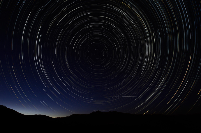 A multiple exposure picture taken in the early hours of August 11, 2013 shows a Perseids meteor shower in the sky, near the municipality of La Hiruela, on the mountains of the Sierra Norte de Madrid (AFP Photo / Dani Pozo)
