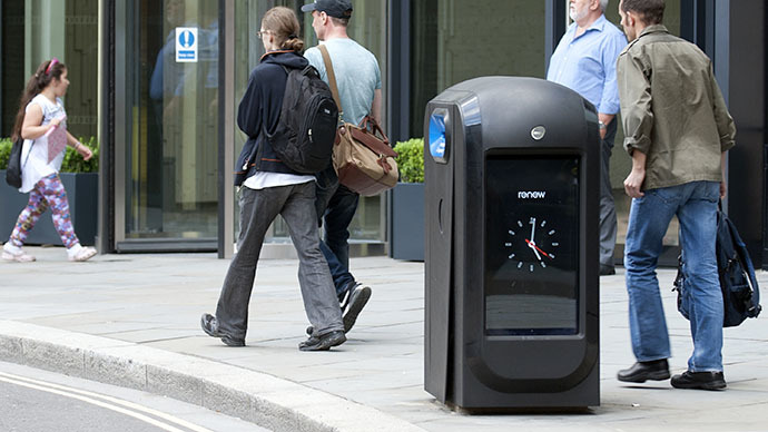 "People walk past a ""pod"" high-tech trash bin in the City of London (AFP Photo / Mona Boshnaq)"