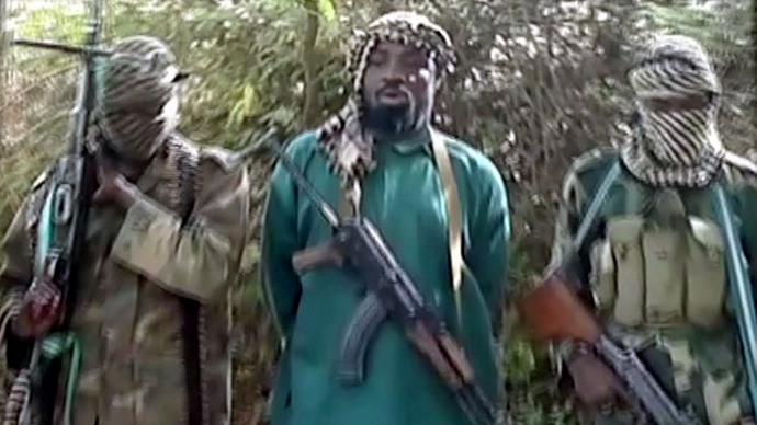 A picture taken from a video distributed to Nigerian journalists in the country's north reportedly shows the suspected leader of Nigerian Islamist extremist group Boko Haram (AFP Photo)