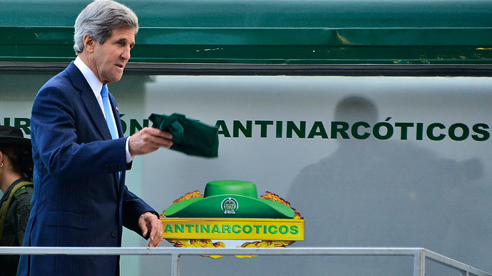 US Secretary of State John Kerry visits the anti-narcotics air base in Bogota on August 12, 2013.(AFP Photo / Luis Acosta)