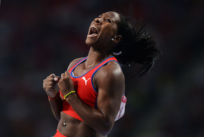 Cuba's Yarisley Silva celebrates after clearing the bar during the women's pole vault final at the 2013 IAAF World Championships at the Luzhniki stadium in Moscow on August 13, 2013 (RIA Novosti / Aleksei Filippov)