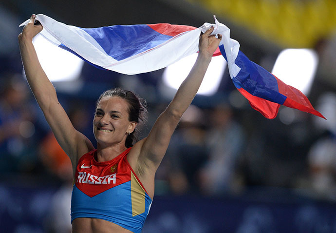 Russia's Elena Isinbayeva celebrates after winning the women's pole vault final at the 2013 IAAF World Championships at the Luzhniki stadium in Moscow on August 13, 2013. (RIA Novosti / Aleksei Filippov)
