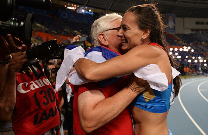 Russia's Elena Isinbayeva celebrates with her coach after winning the women's pole vault final at the 2013 IAAF World Championships at the Luzhniki stadium in Moscow on August 13, 2013. (RIA Novosti / Aleksei Filippov)