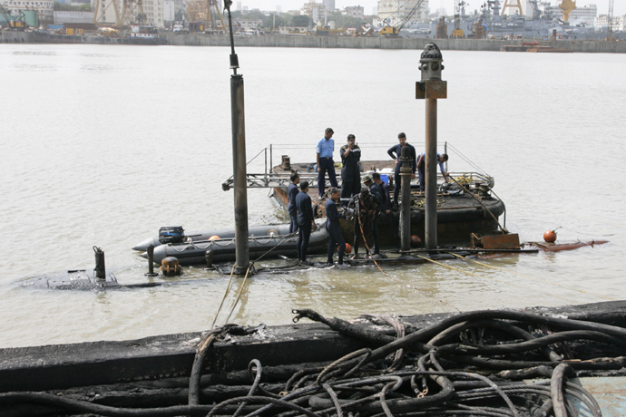 Indian Navy divers at the conning tower of the stricken INS    Indian Navy Submarine