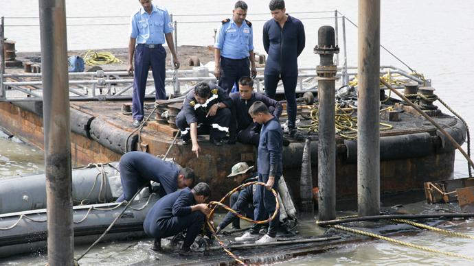 Indian divers enter sunken vessel to reach 18 sailors feared dead