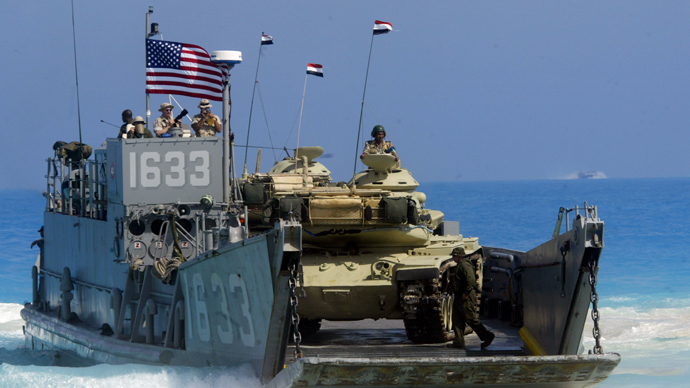 Obama scraps Egypt military drill after crackdown, keeps aid intact