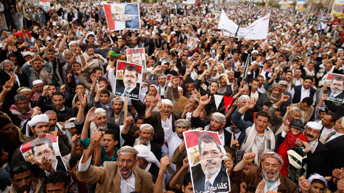Supporters of Egypt's deposed Islamist President Mohamed Mursi shout slogans during a rally in protest of the recent violence in Egypt, in Sanaa August 16, 2013.(Reuters / Khaled Abdullah)