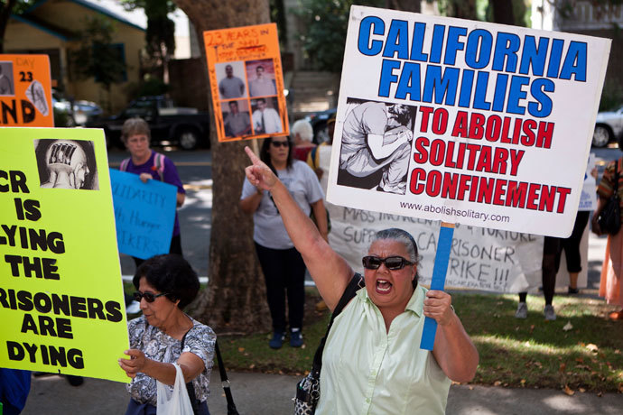 Christina Reyes holds a banner as she protests against indefinite solitary confinement in California prisons, outside the California Department of Corrections and Rehabilitation office in Sacramento, California July 30, 2013. (Reuters / Max Whittaker)