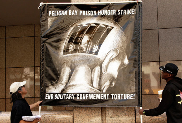 Men hold up a sign during a rally supporting hunger strikers in the California prison system in Los Angeles, California July 29, 2013. (Reuters / Jonathan Alcorn)