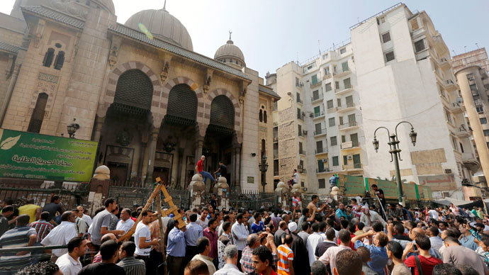 Egyptian Christians attacked, dozens of churches torched