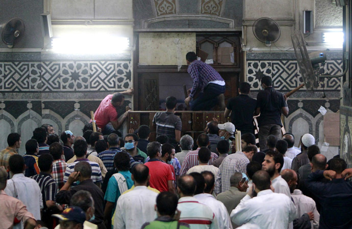 Demonstrators in support of ousted Egyptian President Mohamed Mursi wait by the barricaded door inside al-Fath mosque at Ramses Square in Cairo August 17, 2013. (Reuters/Mohamed Abd El Ghany)