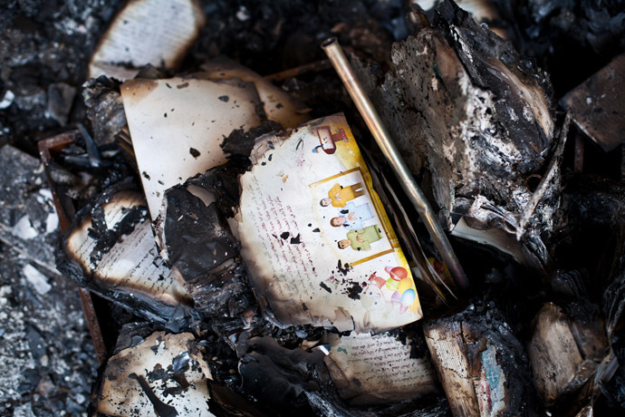 A picture taken on August 18, 2013 shows burnt books in the Amir Tadros coptic Church in Minya, some 250 kms south of Cairo, which was set ablaze on August 14, 2013. (AFP Photo/Virginie Nguyen Hoang)