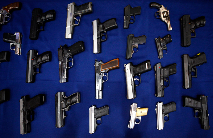 Seized guns are pictured at the police headquarters in New York August 19, 2013 (Reuters / Eric Thayer)