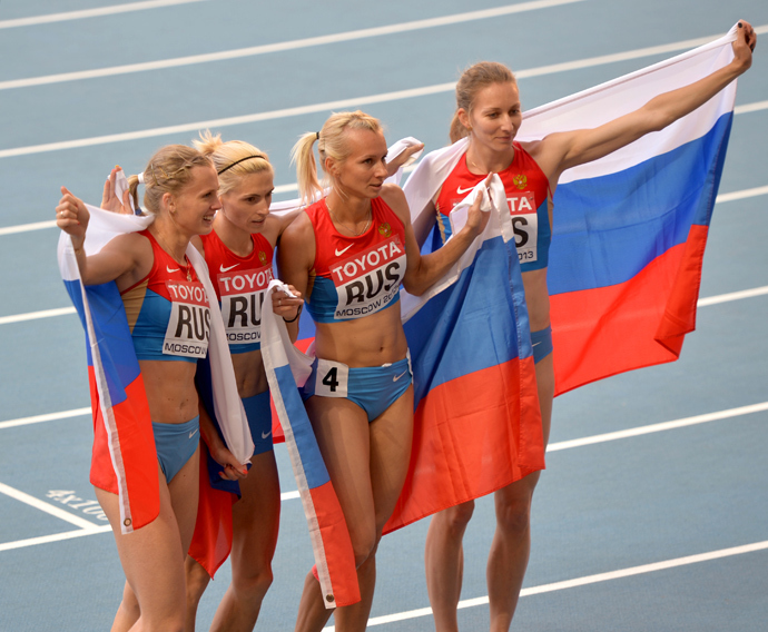 (L-R) Russia's Kseniya Ryzhova, Antonina Krivoshapka, Yulia Gushchina and Tatyana Firova after the women's 4x400m final relay race at the 2013 World Championships in Athletics in Moscow (RIA Novosti / Iliya Pitalev)