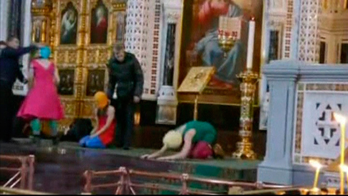 "Members of the female punk band ""Pussy Riot"" stage a protest inside Christ The Saviour Cathedral in Moscow in this still image taken from file video February 21, 2012 (Reuters / Pussy Riot Group / Reuters TV / Handout)"