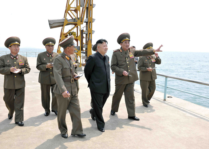 North Korean leader Kim Jong Un (C) inspecting a supply base on the east coast under the Korean People's Army (KPA) Unit 639 at an undisclosed place in North Korea (AFP Photo / KCNA via KNS)