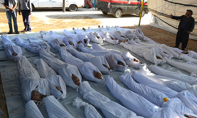 Syrian activists inspect the bodies of people they say were killed by nerve gas in the Ghouta region, in the Duma neighbourhood of Damascus August 21, 2013. (Reuters)