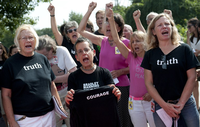 Supporters of US Army Private First Class Bradley Manning react after attending his sentencing hearing at a US military court facility at Fort Meade, Maryland on August 21, 2013. (AFP Photo / Saul Loeb)