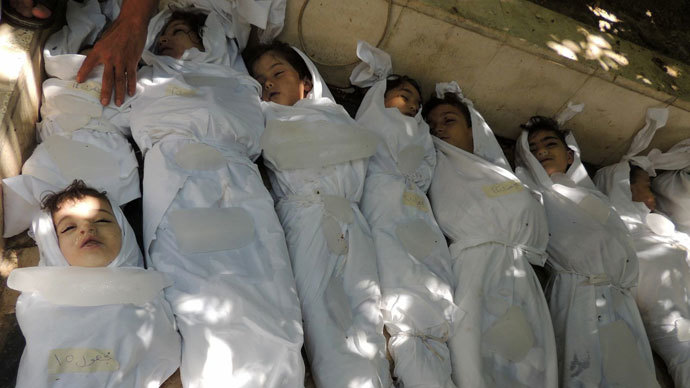A handout image released by the Syrian opposition's Shaam News Network shows bodies of children wrapped in shrouds laid out on the ground as Syrian rebels claim they were killed in a toxic gas attack by pro-government forces in eastern Ghouta, on the outskirts of Damascus on August 21, 2013.(AFP Photo / Daya Al-Deen)