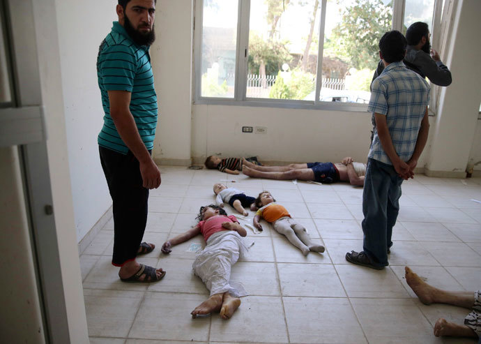 A view shows bodies of children whom activists say were killed by gas attack in the Ghouta area, in the eastern suburbs of Damascus August 21, 2013.(Reuters / Mohamed Abdullah)