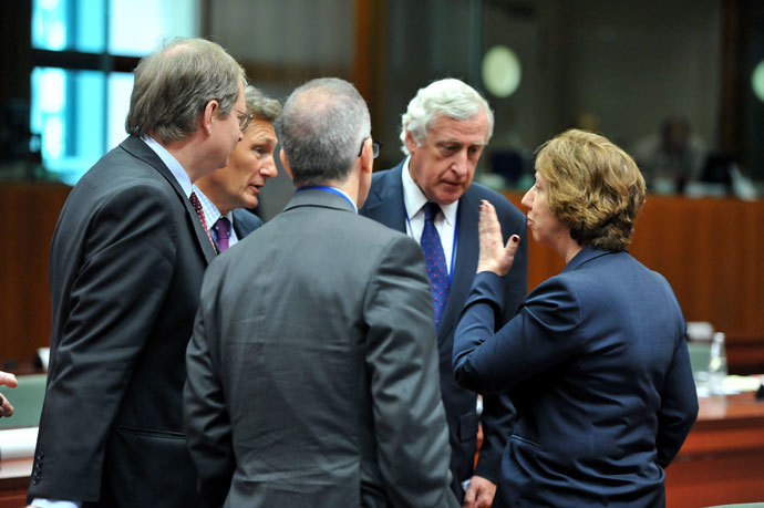 General Secretary for EU external Affairs Pierre Vimont (2nd R) and unidentified members of his staff talk with the High Representative of the European Union for Foreign Affairs and Security Policy Catherine Ashton (R) before an extraordinary EU Foreign Affairs Council on August 21,2013 at the European Headquarters.(AFP Photo / Georges Gobet)