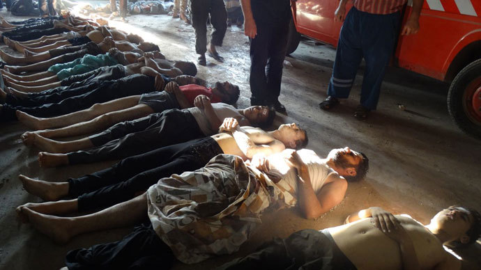 A handout image released by the Syrian opposition's Shaam News Network shows bodies of boys and men lined up on the ground in the eastern Ghouta suburb of Damascus, whom the Syrian opposition said on August 21, 2013 were killed in a toxic gas attack by pro-government forces.(AFP Photo / Shaam News Network)