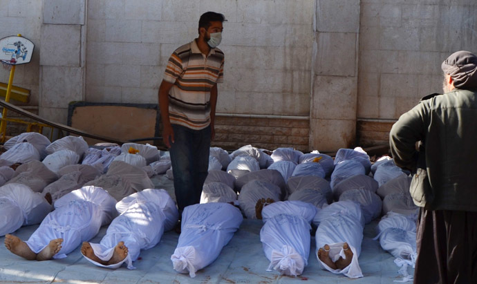 Syrian activists inspect the bodies of people they say were killed by nerve gas in the Ghouta region, in the Duma neighbourhood of Damascus August 21, 2013. (Reuters/Bassam Khabieh)