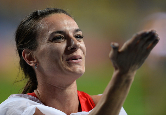 Yelena Isinbayeva (Russia) after her win in the women's pole vault final at the World Championships in Athletics in Moscow. (RIA Novosti/ Alexey Filippov)