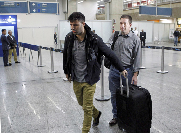 David Miranda (L) -- the Brazilian partner of Glenn Greenwald, a US journalist with Britain's Guardian newspaper who worked with intelligence leaker Edward Snowden to expose US mass surveillance programmes -- is pictured at Rio de Janeiro's Tom Jobim international airport upon his arrival on August 19, 2013. (AFP Photo/O Globo)