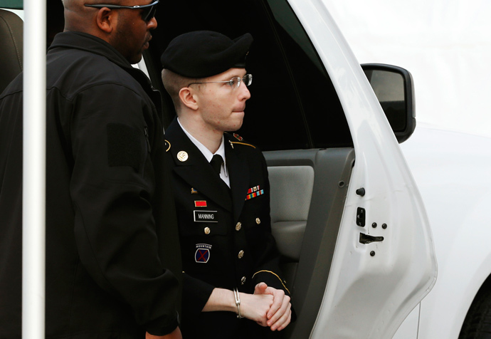 U.S. soldier Bradley Manning is escorted into court to receive his sentence at Fort Meade in Maryland August 21, 2013 (Reuters / Kevin Lamarque)