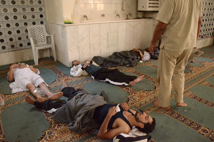 urvivors from what activists say is a gas attack rest inside a mosque in the Duma neighbourhood of Damascus August 21, 2013 (Reuters / Bassam Khabieh)