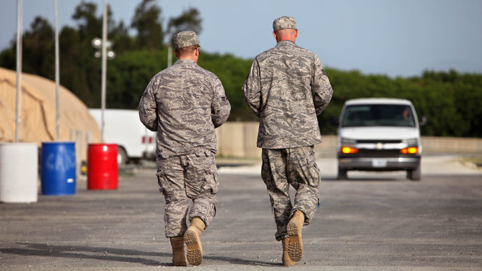 In this photo, reviewed by the US military, US troopers walk on the grounds of the Camp Justice compound, the site of the US war crimes tribunal, at Guantanamo Bay US Naval Base, Cuba, Thursday, July 16, 2009.(AFP Photo / Brennan Linsley)