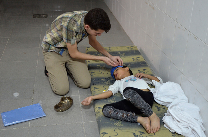 A boy, affected by what activists say was a gas attack, is treated at a medical center in the Damascus suburbs of Saqba, August 21, 2013 (Reuters / Bassam Khabieh)