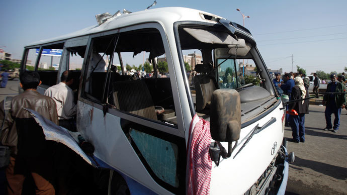 Forensic experts inspect a bus after a bomb attack in Sanaa August 25, 2013.(Reuters / Khaled Abdullah)