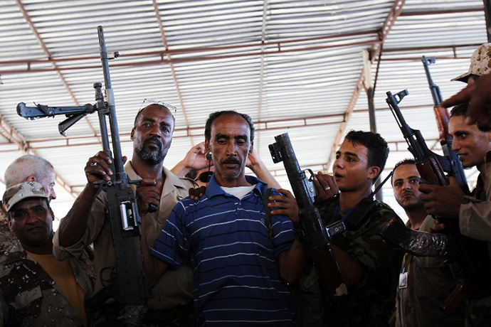 Libyans queue to hand over weapons and ammunition to the military during a ceremony at Freedom Square in the eastern city of Benghazi on September 29, 2012. (AFP Photo / Abdullah Doma)
