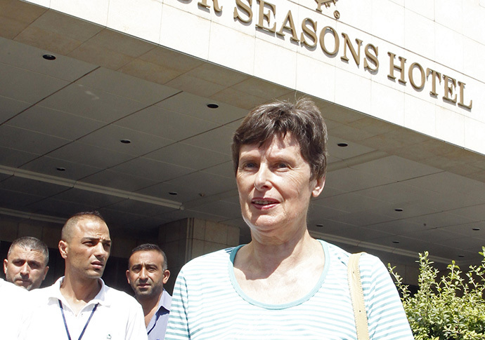 United Nations (U.N.) High Representative for Disarmament Affairs Angela Kane stands outside a hotel to watch a convoy of U.N. inspectors heading to the scene of an alleged chemical weapons strike in the rebel-held area known as Eastern Ghouta, on the outskirts of the capital Damascus August 26, 2013. (Reuters / Khaled Al Hariri)