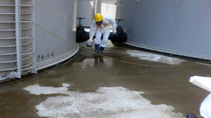A TEPCO worker checking radiation levelS around a contaminated water tank at TEPCO's Fukushima Dai-ichi nuclear power plant at Okuma town in Fukushima prefecture. (AFP Photo / TEPCO)