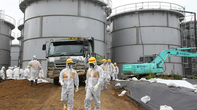 Nuclear watchdog members including Nuclear Regulation Authority members in radiation protection suits inspecting contaminated water tanks at the Tokyo Electric Power Co Fukushima Dai-ichi nuclear power plant (AFP Photo /  Nuclear Regulation Authority)