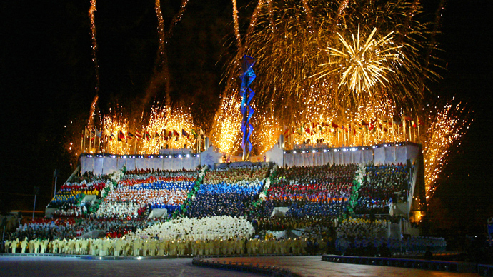 Fireworks blaze 08 February 2002 during the opening ceremonies of the 2002 Winter Olympics at the Rice Eccles Stadium in Salt Lake City (AFP Photo / Timothy A. Clary)