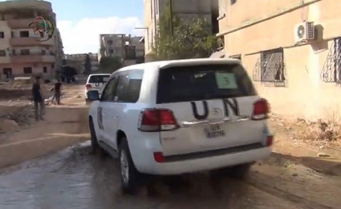 An image grab taken from a video uploaded on YouTube by Moadamiyet al-Sham media centre on August 26, 2013 allegedly shows the United Nations (UN) arms experts convoy leaving Damascus' Moadamiyet al-Sham suburb following an inspection visit on August 26 to investigate an alleged chemical weapons strike near the capital. (AFP Photo)