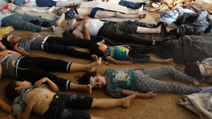Syrian opposition's Shaam News Network shows bodies of children and adults laying on the ground as Syrian rebels claim they were killed in a toxic gas attack by pro-government forces in eastern Ghouta, on the outskirts of Damascus on August 21, 2013.(AFP Photo / Shaam News Network)